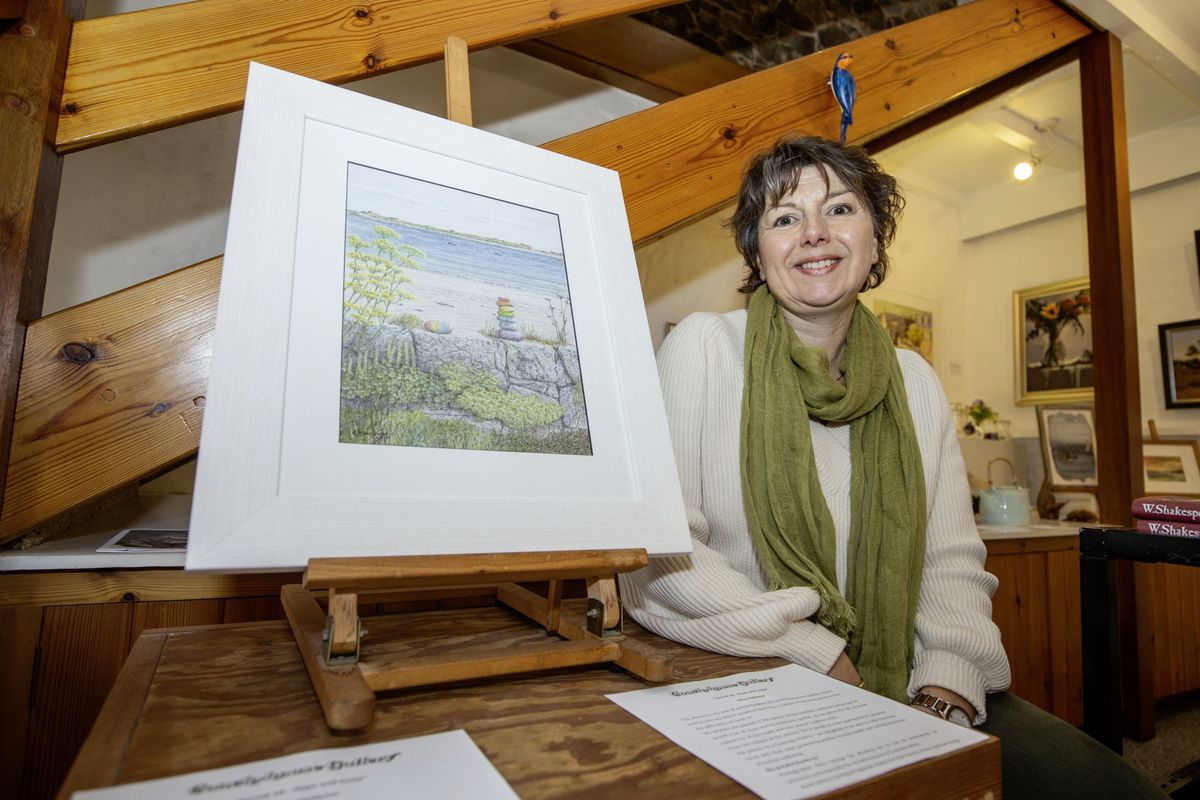 Guernsey Mind general manager Jo Cottell with John Challenor's work, which is raising money for the charity. (Picture by Sophie Rabey, 28849714)