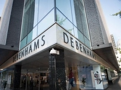 Mike Ashley claims Debenhams on the brink as he offers £40m loan