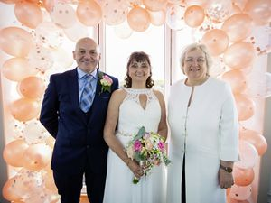 Picture by Sophie Rabey.  16-04-21.  First legal non-church wedding (under the new law) happened today at Jerbourg Hotel.  Cathy and Andy Jones on their wedding day with celebrant, Jayne White.. (29448418)
