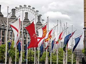 The Guernsey flag flying outside the Houses of Parliament, along with those of the other countries and crown dependencies of the UK. (Jane Rix/Shutterstock.com) (24127799)