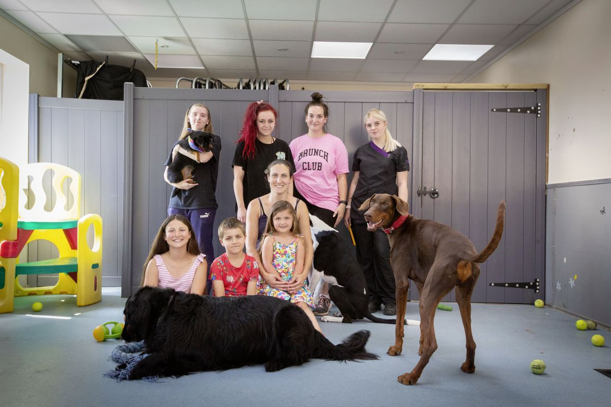 Four Paws Country Pet Hotel's staff and family. The business have seen a downturn in numbers as people are not choosing to travel. (Picture by Cassidy Jones, 29787200)