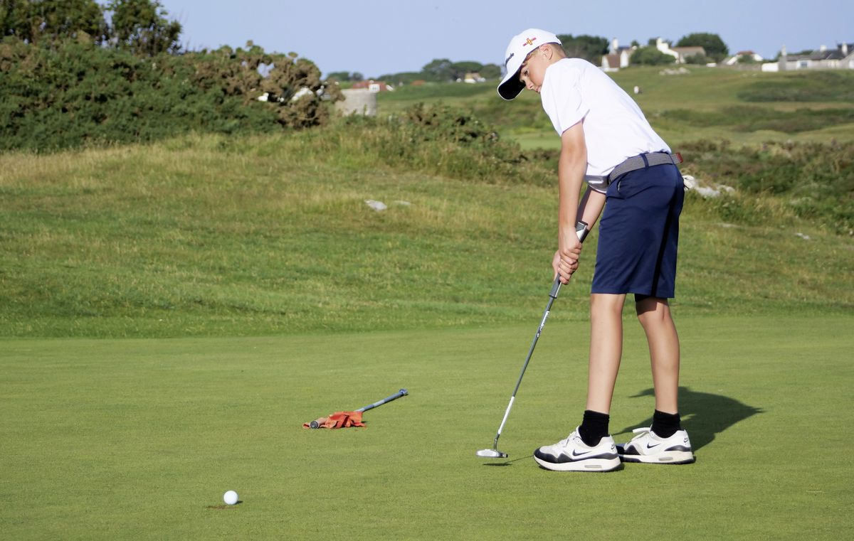 Conor McKenna holing out on the 12th. (Picture by Gareth Le Prevost, 29782001)
