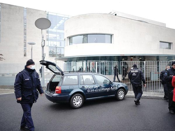 Car hits gate outside Merkel's offices