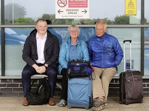 Waiting patiently outside after their flights were cancelled are, left to right, Adam Lamoury, Helen and John Hardy. (Pictures by Adrian Miller, 24797462)