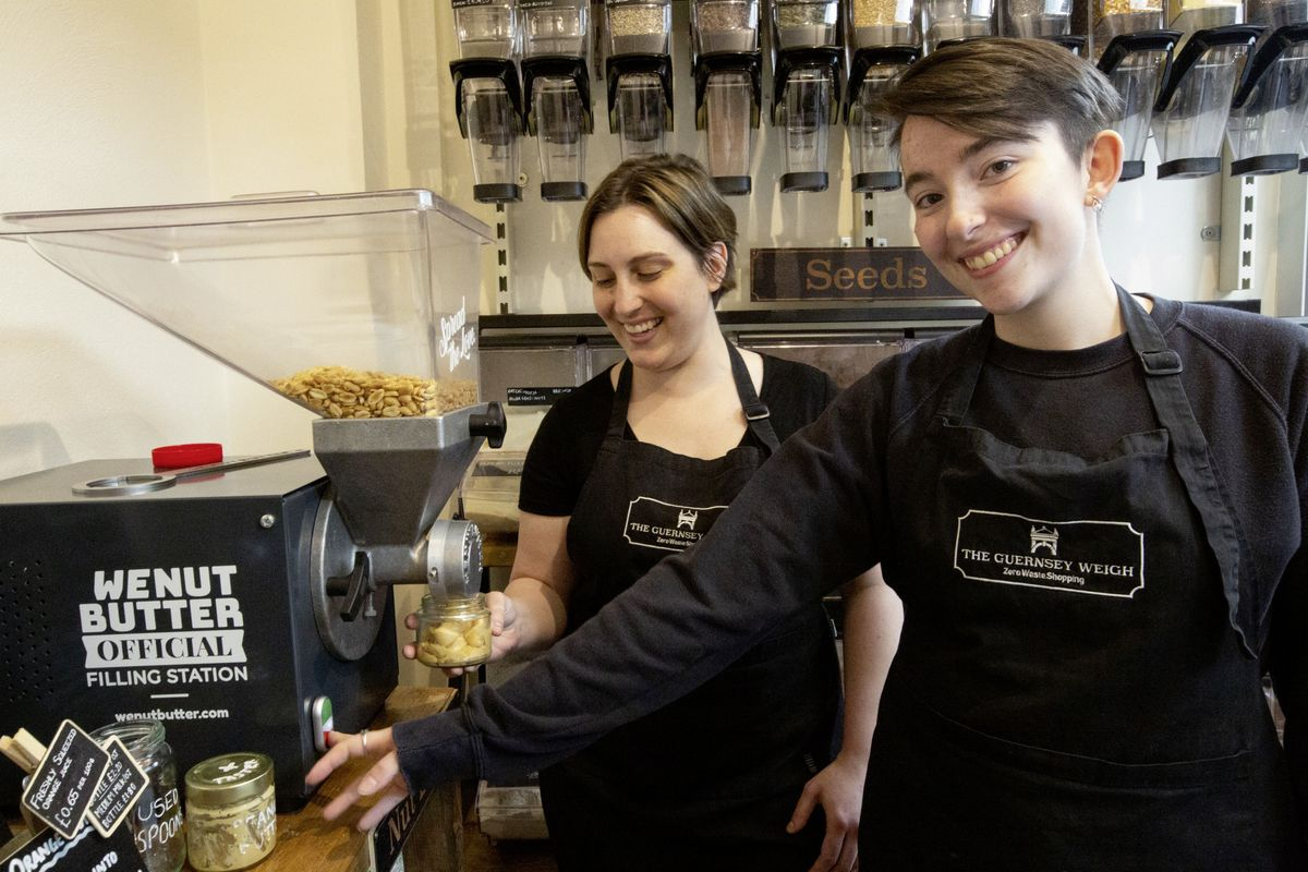 Guernsey Weigh staff celebrating the shop's second birthday. Left to right: Ashley Laymon-Ogier and Sapphire brewer-Marchant. (Picture by Cassidy Jones, 29639249)