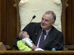 New Zealand parliament speaker soothes baby as debate rages
