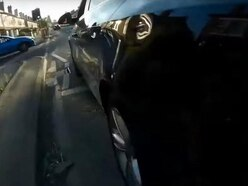 Jail for 'smirking' driver caught on camera knocking cyclist off bike
