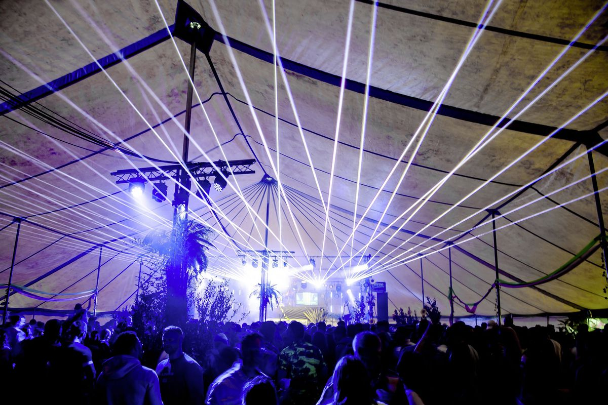 Laser light illuminates the Tropical Dance Tent. (Picture by Andrew Le Poidevin)