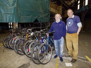 Allister Carey and Terry Iles with some of the bikes that have been donated to the Eleanor Foundation. (Picture by Sophie Rabey, 29416462)