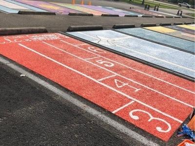 Seniors at Louisiana high school paint school parking spots into custom murals