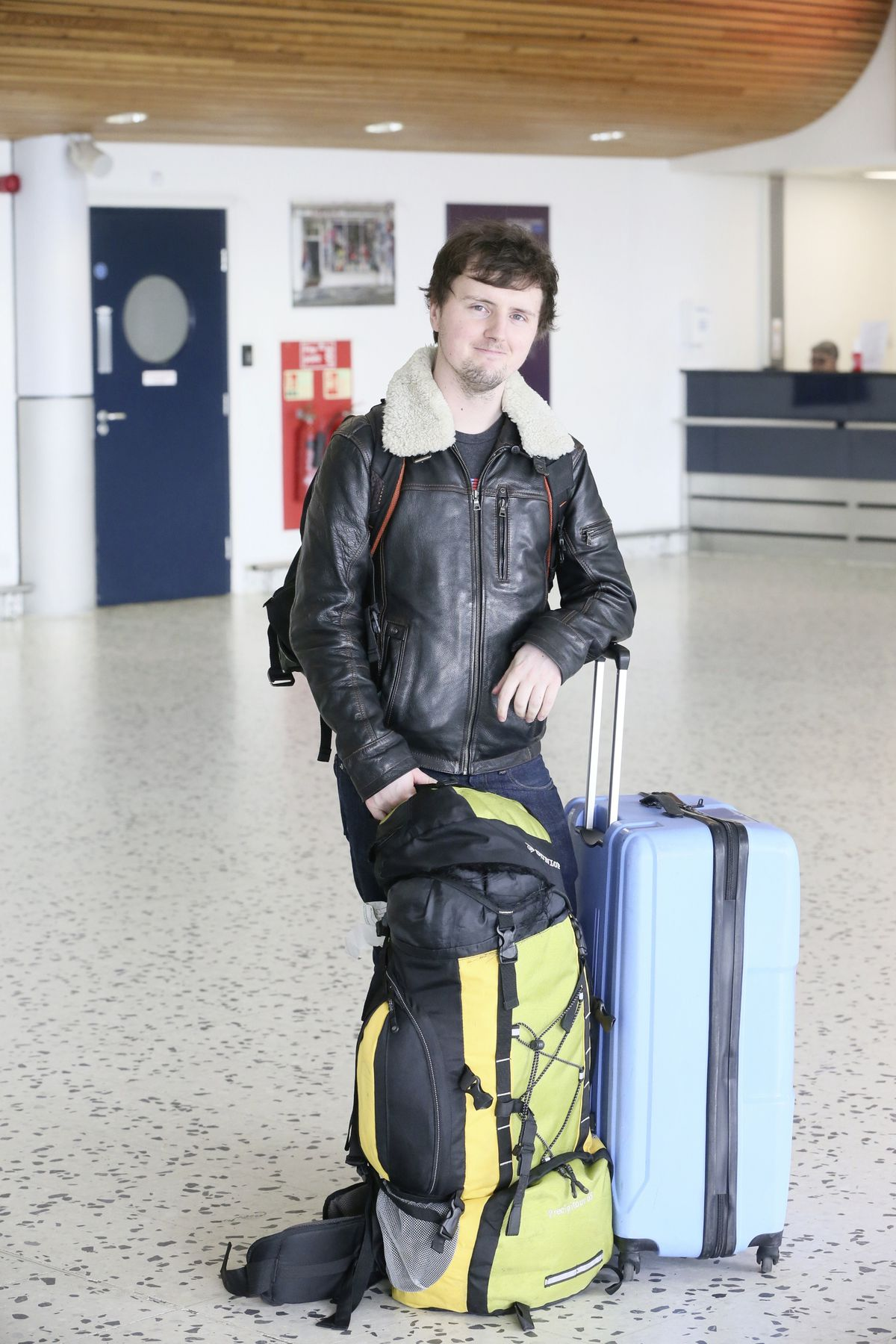 Pic by Adrian Miller 18-03-20 Airport vox pop passengers arriving back home from UK . James Cottam 23. (27535415)