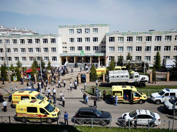 Students and teacher killed in shooting at Russian school