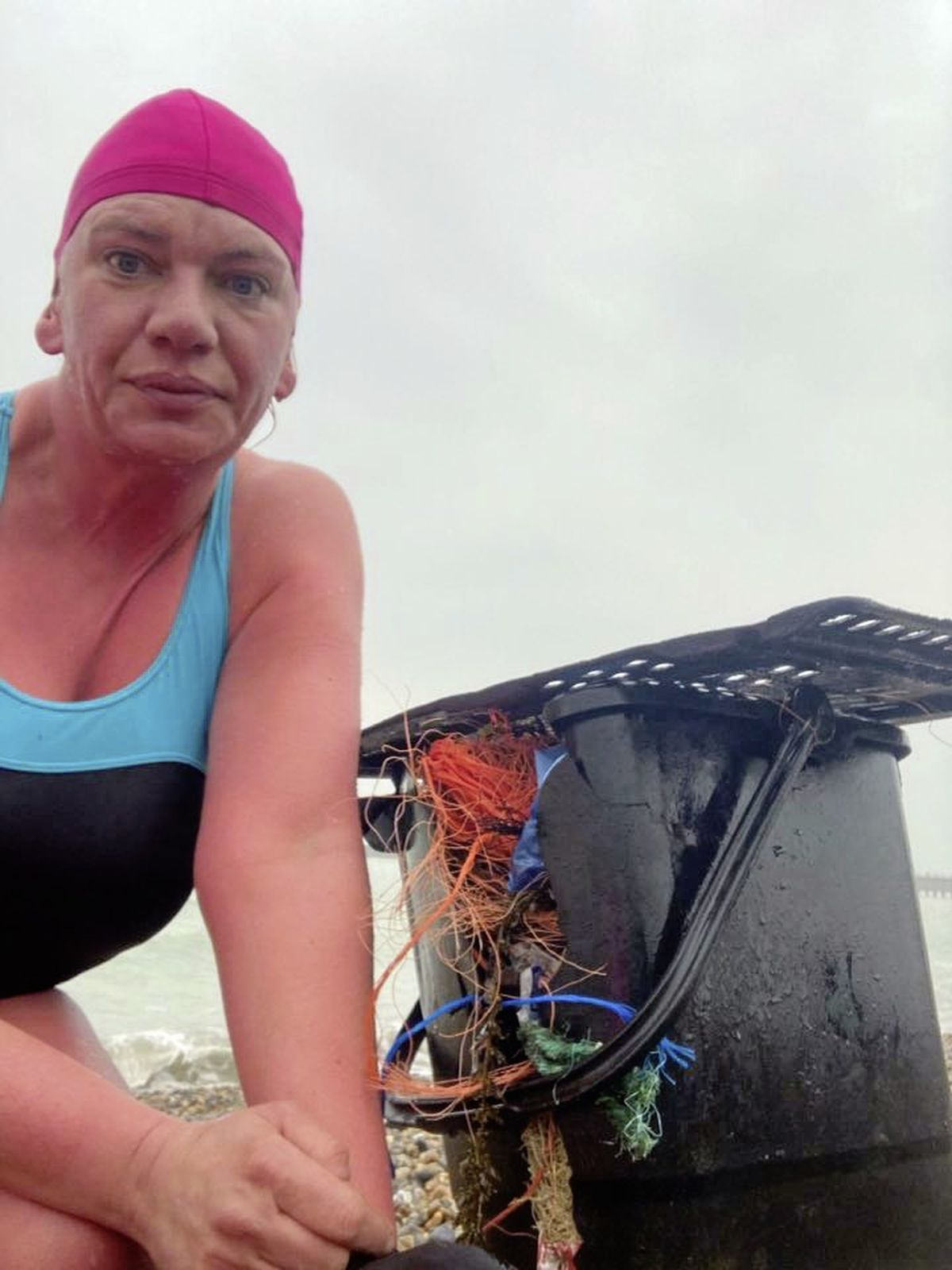 Claire Sumners with the Guernsey food caddy she found on the beach at Seaford. (29270377)