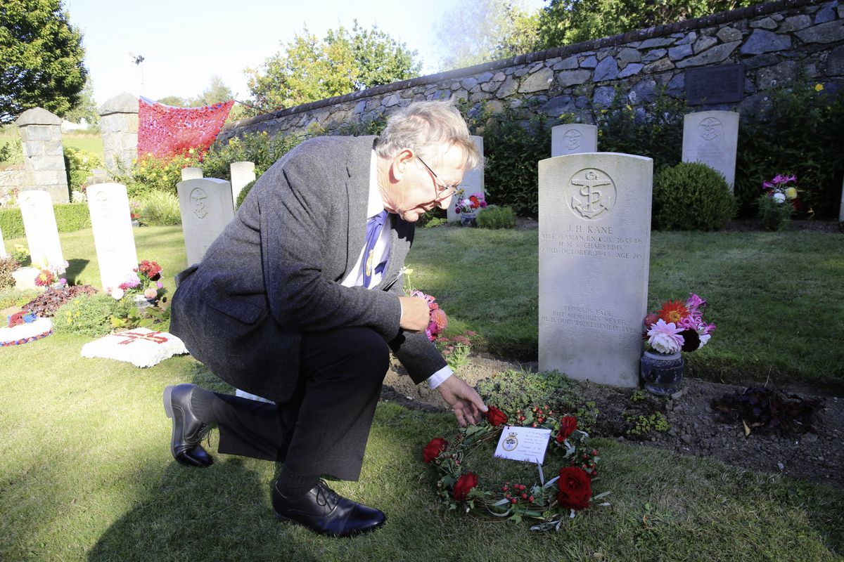 Pic by Adrian Miller 27-09-20 Foulon Cemetery. Remembrance service for H.M.S. Charybdis and H.M.S. Limbourne . Peter Carey member of the Charybdis and Limbourne Association lays a wreath.. (28735087)