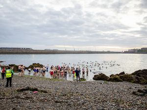 Swimmers at Havelet Bay for The Cheshire Home Sunrise Swim. (Picture by Sophie Rabey, 29676289)