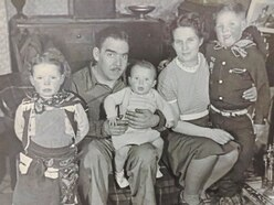 Visit by family of first liberator to land put back 12 months