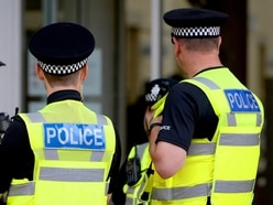Murder inquiry after man attacked in car