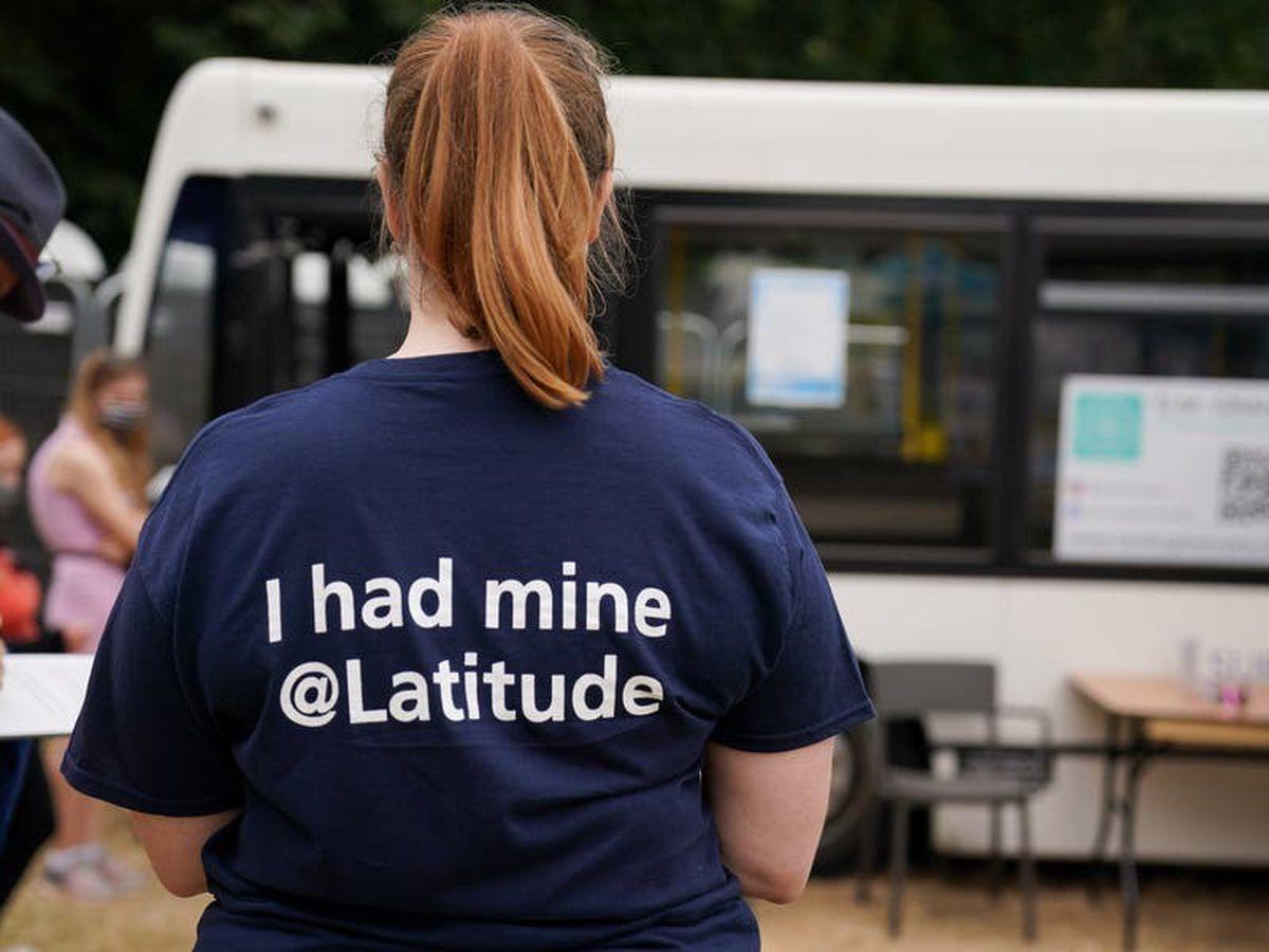 Vaccinators dubbed the 'Pfizer Chiefs' man jab bus at Latitude