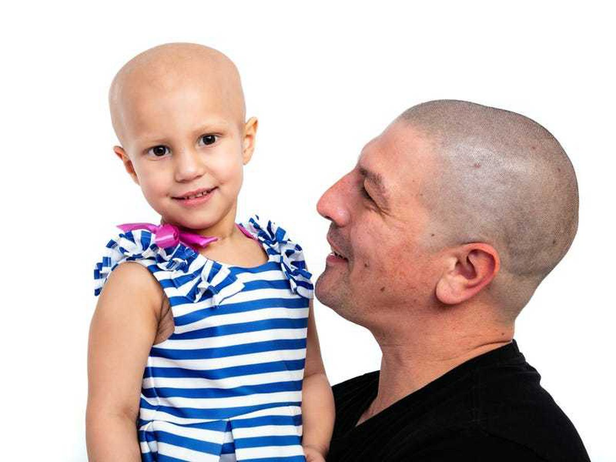 Father gets tattoo on his head to match daughter's brain surgery scar