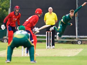 Cricket at Farmer's Filed. Inter-insular Jersey (red) v Guernsey (green). R>L Matthew Stokes bowls to Jonty Jenner                                                             Picture: ROB CURRIE. (29804201)