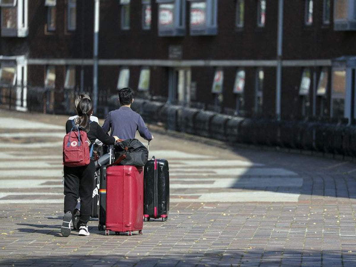 How can university students return home safely for Christmas?