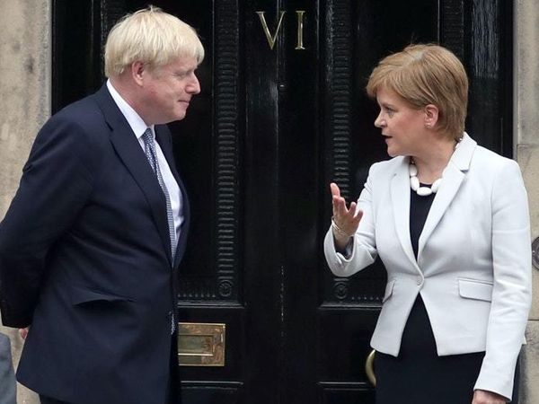 Prime Minister Boris Johnson with Nicola Sturgeon, First Minister of Scotland, which counts Covid-related deaths differently to England. (28568484)