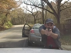 Dramatic dashcam video shows man shooting at officer during traffic stop