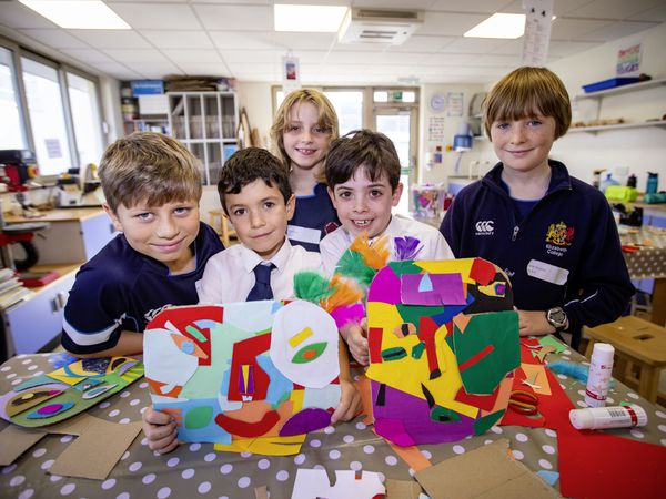 Elizabeth College Junior School pupils are being challenged to increase their fitness while also nurturing their inner explorer.A new initiative called Climbing Together has been launched, which involves the students recording their daily physical activity and converting it into distance climbed virtually up a mountain. Left to right: Benedict Rodrigues de Brito, 10, Jesse Willis, 7, James Creasey, 6, Grace Isbister, 9, and Jacob Sheward, 10, with their artwork representing North America, having learned about Denali, also known as Mount McKinley. (Picture by Sophie Rabey, 30011770)