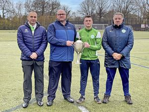 The Stranger Cup is being sponsored for the first time in its long history with Ross Gower backing the competition in the 2020-21 season. Left to right: James Falla (GFA director), Gareth Burchell (director, Ross Gower), Oscar Leadbeater (representing Guernsey U18s), Colin Fallaize (Guernsey U18s coach).  Picture supplied 06-01-21. (29083211)