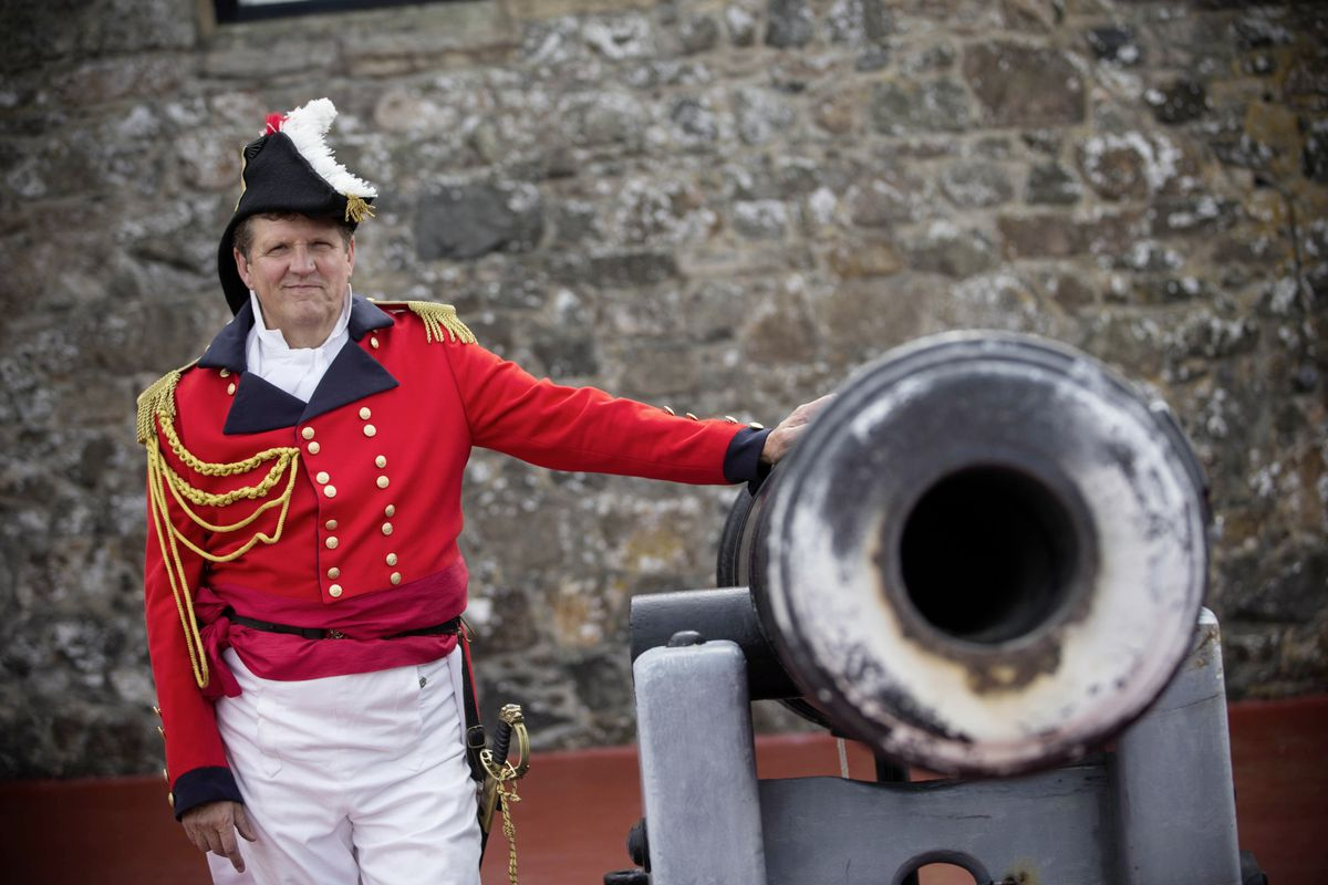 Outgoing States of Guernsey head of heritage services Jason Monaghan at Castle Cornet dressed as Sir Isaac Brock for his noonday gun firing to signal his last day in the job. (Picture by Peter Frankland, 25935824)