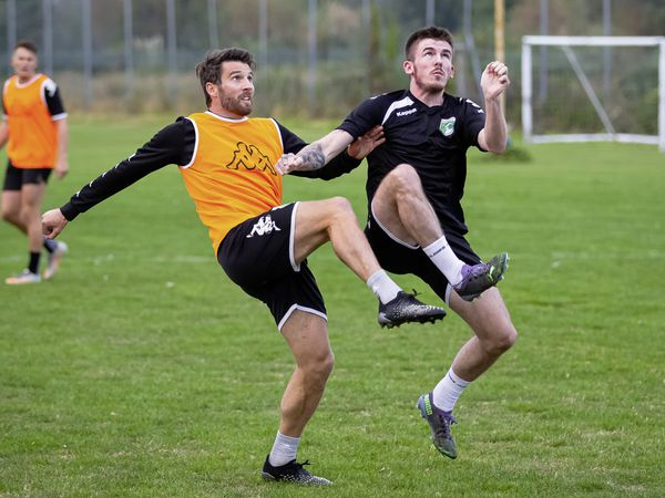 Happy feet: Ross Allen and Charlton Gauvain challenge for a dropping ball as the GFC squad train at Victoria Avenue. (Picture by Martin Gray, 30018749)