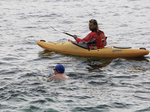 Novice sea swimmer Guy Hardill on his charity swim from the bathing pools and back. Pictured with him in the safety kayak is Phil Le Poidevin from Go Guernsey. (Pictures by Adrian Miller, 28331733)