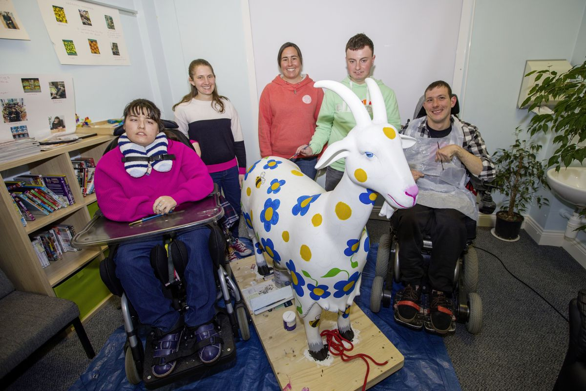 Guernsey Adult Disability Service users have been painting Guiding's goat for the Golden Guernsey Goat Trail, which will raise money for Autism Guernsey and the Guernsey Adult Literacy Project. Left to right, Chloe Turner, Natalie Wrigley, Sam Bailey, Lucy Slimm and Dean Doherty.  (Picture by Sophie Rabey, 29411966)