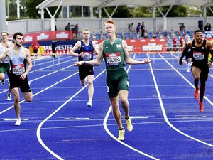 Golden moment: Alastair Chalmers wins the 400m hurdles national title in Manchester.