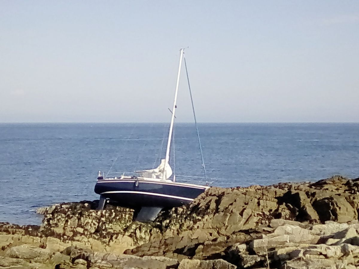 Greg Richardson took the picture of the yacht on the rocks. It was floated off on the next high tide.