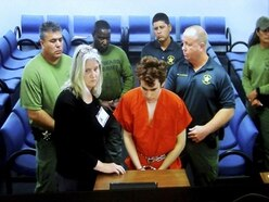 Under-fire sheriff's deputy refuses to testify about school massacre