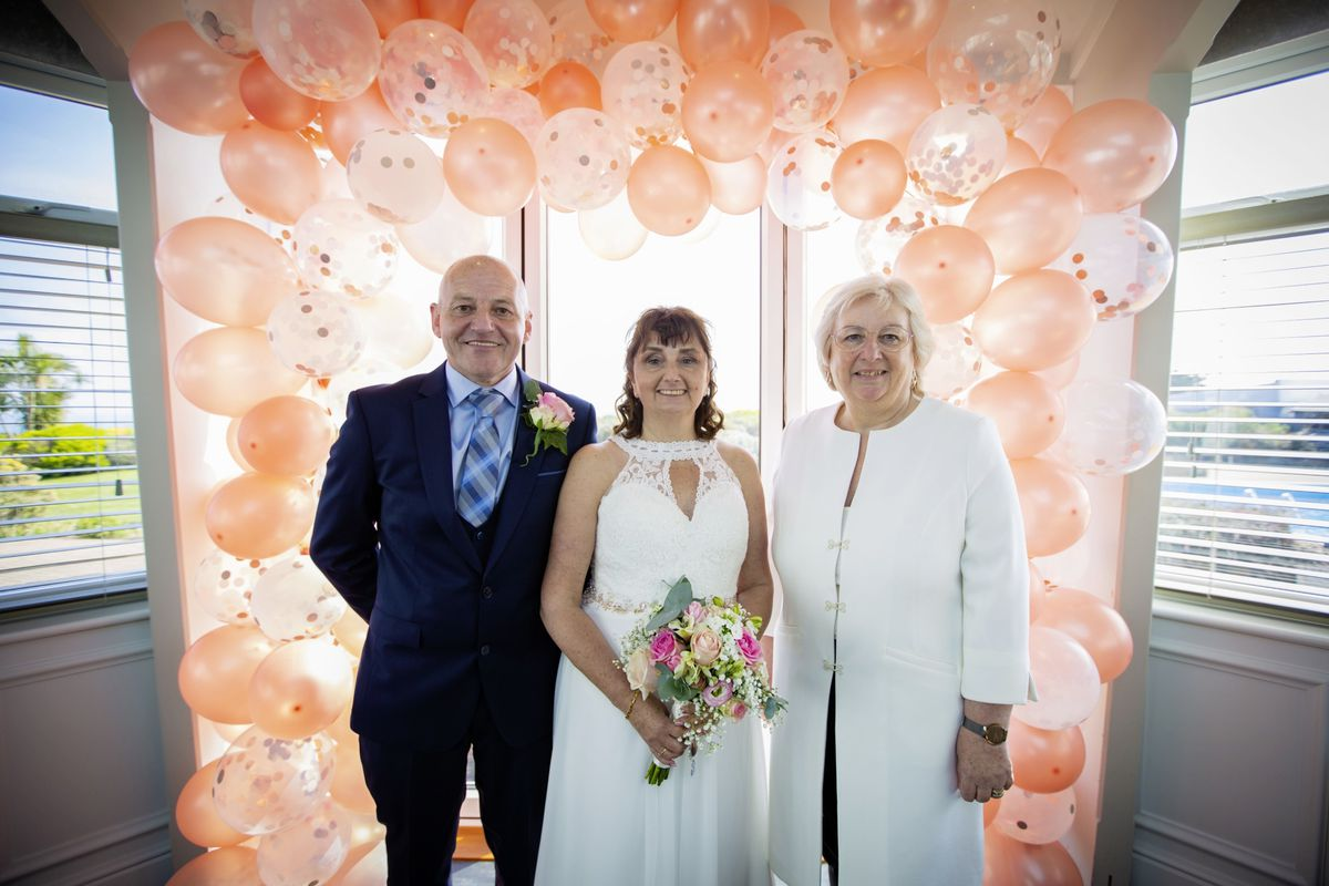 Cathy and Andy Jones with celebrant Jayne White at Jerbourg Hotel yesterday. The event was the first legal non-church wedding under the new law. (Picture by Sophie Rabey, 29448418)