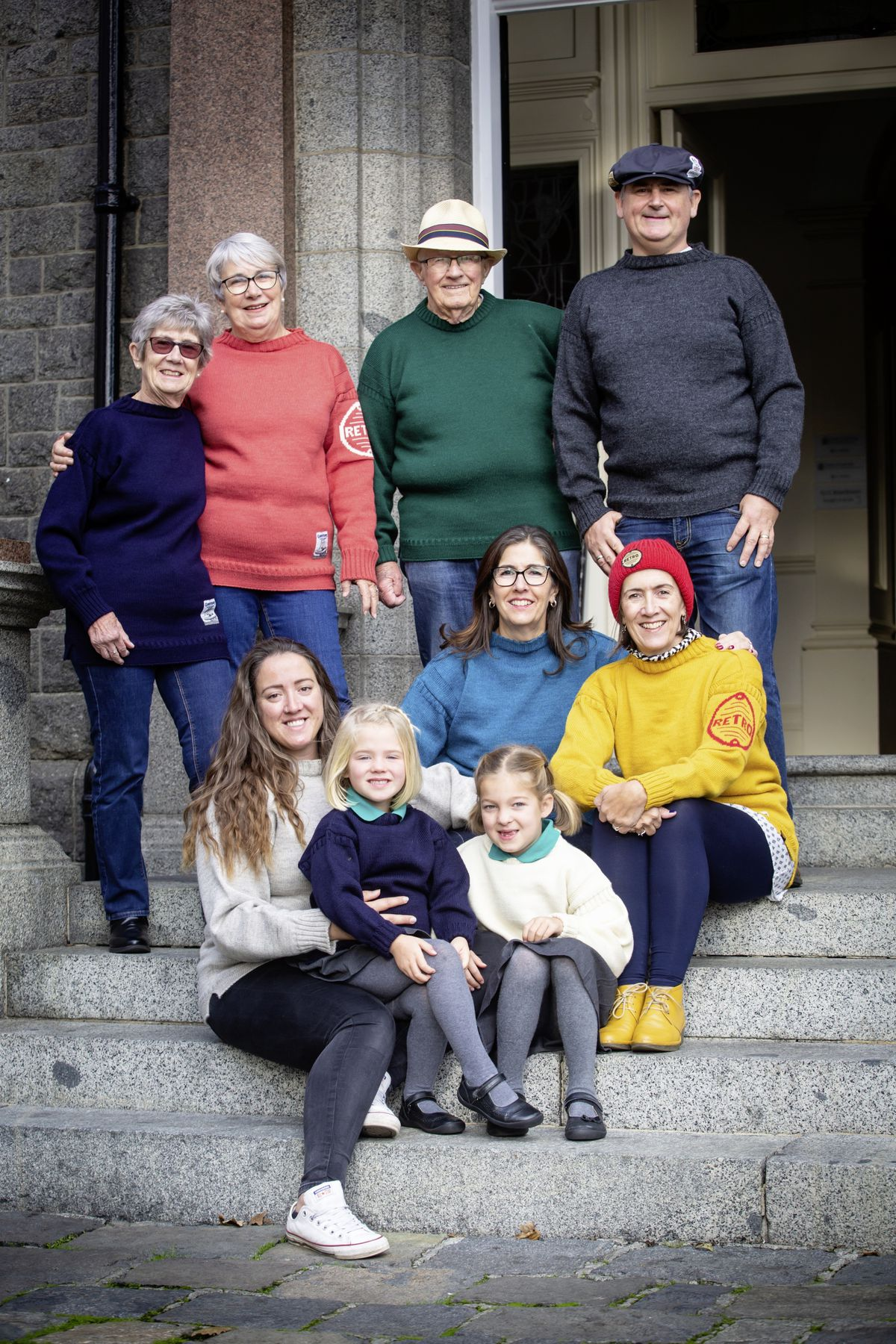Four generations of one family wearing Guernsey jumpers took part in yesterday's Wear a Guernsey Day at the Tourist Information Centre. Left to right, back, Val Bailey, Ann Carroll, Don Bailey, Quentin Vohmann. Middle, Louise Sands, left, and Alison Vohmann. Front, left to right, Jemma Wilson with Ren Breaton, 4, and Eden Breaton, 6. 	(Picture by Peter Frankland, 28930429)