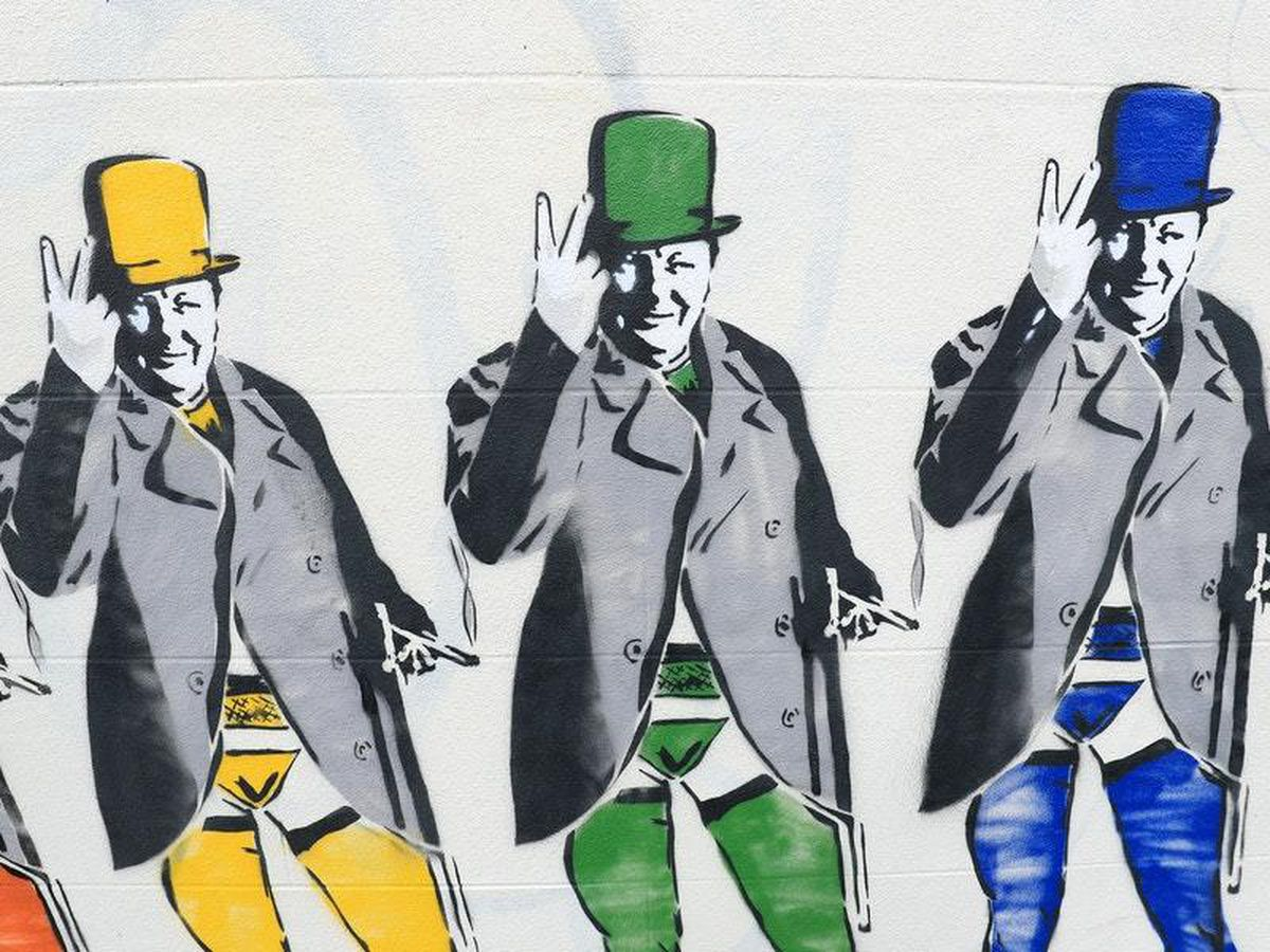 Rainbow mural of Churchill in stockings and suspenders allowed to stay in place