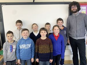 Students from Sark School's class 3 with Czech PhD student Martin Neudorfl (Picture supplied by Sark School)
