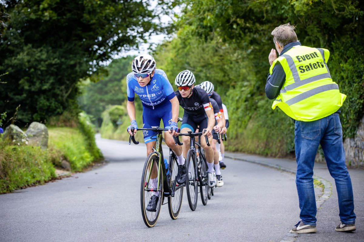 Eventual winner Jack English sits at second wheel as the chasing group are informed of the gap to those ahead at the lap point in yesterday's road race. (Picture by Sophie Rabey, 28612106)