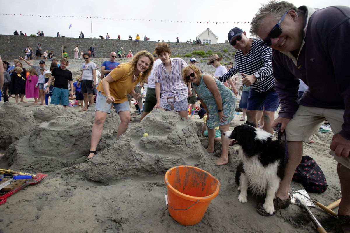 Serious sand castle making with, from left to right, Jenny Oliver, Oscar Oliver, Linda Denton, regatta lifetime patron Rick Denton, Scout the dog and Steven Oliver. (29822219)