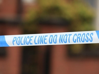 Man arrested after death of camper in Merseyside park