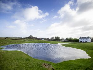 The flooded 10th fairway at L'Ancresse golf course. (Picture By Peter Frankland, 29196306)