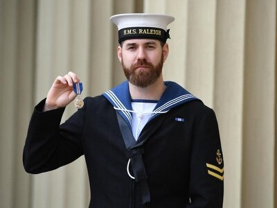 Sailor behind dramatic rescue applauded as he collects Queen's Gallantry Medal