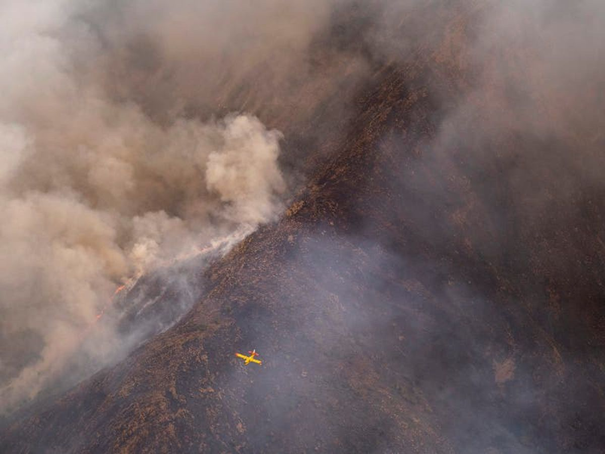 Rainfall helps firefighters control inferno in southern Spain