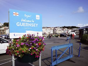 Guernsey, UK: August, 2018: Welcome to Guernsey sign in the harbor for visitors to the island.  (29488083)