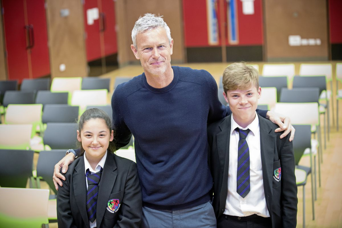 St Sampson's High students Katie Wherry, 14, and Ben Acey, 15, with Olympic swimmer and Team GB flag bearer Mark Foster, who gave an inspirational talk at the school. (24569606)