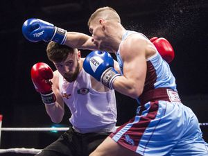 Ready for a re-match: Chris Sumner ducks a punch from James Thompson who he fights again this weekend. (Picture By Peter Frankland, 27197099)
