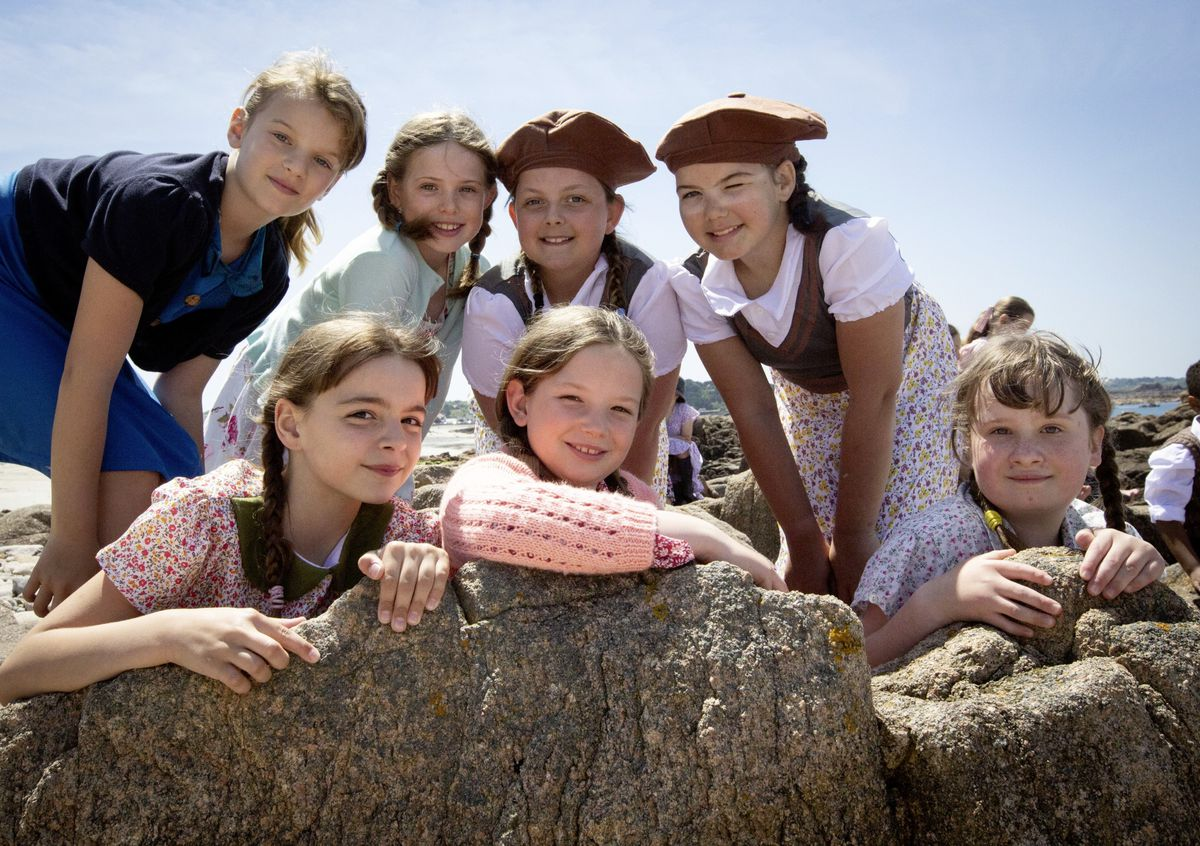 Filming at Grandes Rocques with La Mare de Carteret Primary School for the A La Perchoine musical. Left to right, top row, Lilly-Anne Bichard, Jessica Merrien, Imani Burtenshaw and Tia-Louise Kelling. Bottom row, left to right, Sophie Ferbrache, Maisy Campbell and Angelina Upson. (Picture by Cassidy Jones, 29633178)